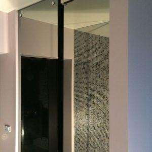 Porte coulissante en miroir - Vitrerie DAVID Sàrl - Yverdon-les-Bains